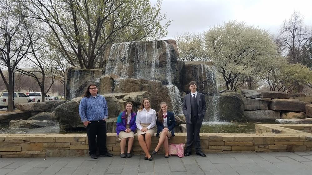 Group of students in front of waterfall in Oklahoma City